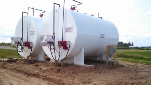 Two Kay Tank storage tanks for the farm with fuel pumps